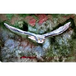Flying great horned owl